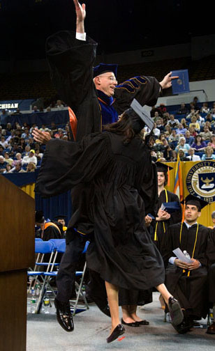 College graduation, dean doing chest bump